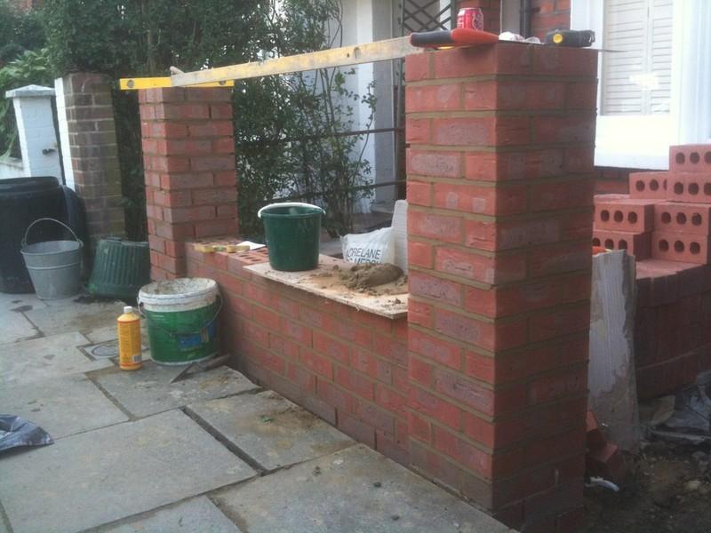 Front garden brick wall designs brick render fence with for Small brick wall designs front garden